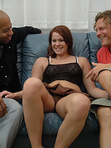 Red head hottie sucks two guys at the same time.