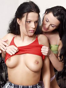 Two raven haired babes share a massive dildo