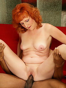 Mature redhead takes a big black cock
