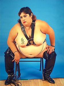 Huge Belly Fat Babe in Dominatrix Look Posing