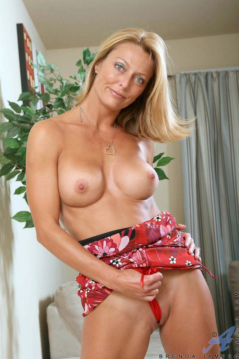 naughty blonde milf massages her perky tits and spreads her pink