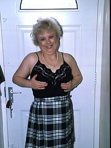 Small boobed grandma Shorley teasing us with her black stockings
