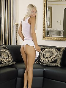 Platinum blonde hottie shows off her sweet ass and breasts