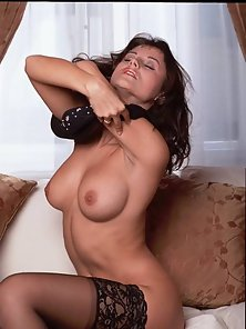 Busty brunette Sonja teasing us with her petite pussy