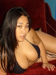 Chubby asian in sexy black lingerie is posing