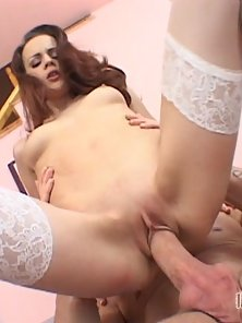 Sexy brunette in a cream filled finaly