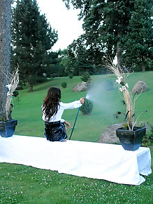 Chicks spraying water with a hose