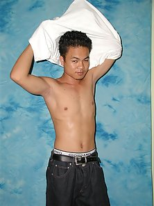 Twink pose naked on blue background wall