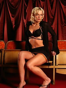 Lustful blonde Angela posing in her sexy black lingerie