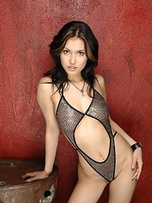 Cute Asian girl Maria Ozawa getting naked in her swimsuit