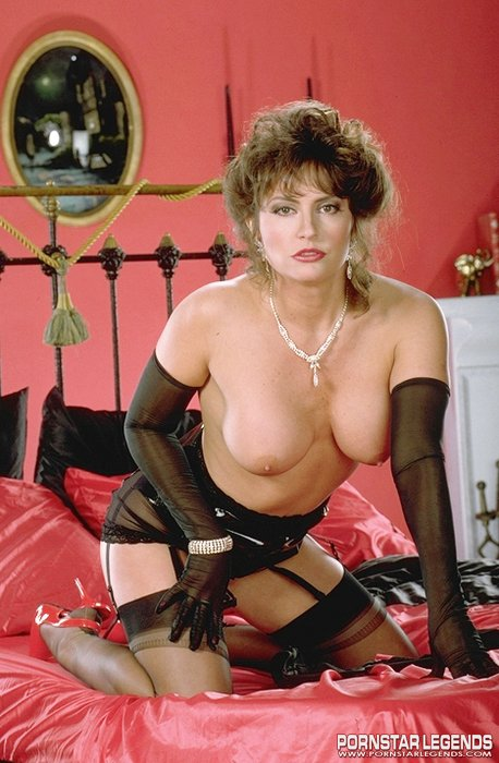 ... Ashlyn Gere in lingerie playing on a bed ...