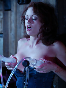 Monica Mayhem enjoys a milking and a machine fucking in the barn.