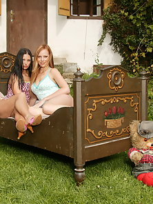 Sexy young babes fucking with dildos outdoors
