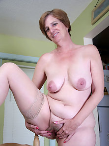 Naughty executive granny takes a quick break to strip off her clothes and flaunt her tits and pussy