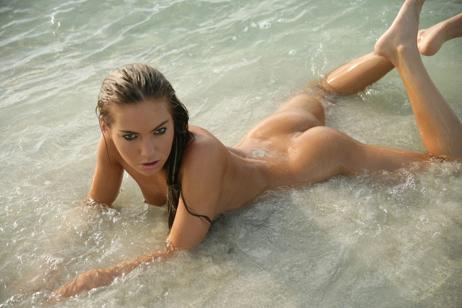 Naked Babe Taking A Swim In The Sea