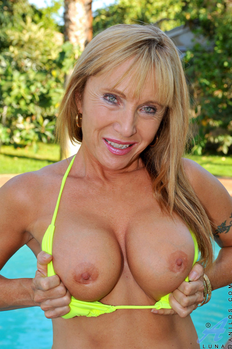 hot mom with massive tits enjoys her pool while floating around