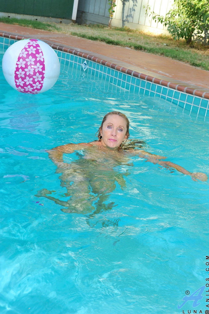 Mom Pool Pussy - ... Hot mom with massive tits enjoys her pool while floating around naked  with a finger in ...