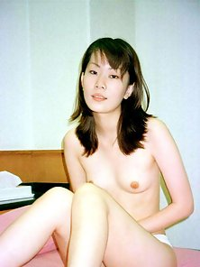 Shy Japanese Amateur shows her hairy wet twat