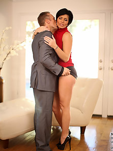 Busty Anilos Shay Fox teases her office mate and she gets a nice couch pounding
