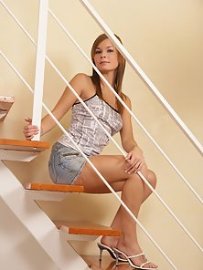 Lucy Lux Shows How She Pleases Her Pussy On The Stairs