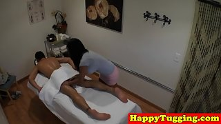 Busty oriental masseuse bouncing on cock