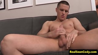 Muscular stud jerking off his shiny knob